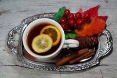Hot tea with lemon in autumn and winter evenings - a festive table Stock Photos