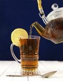 Hot tea with lemon on blue background Royalty Free Stock Photo