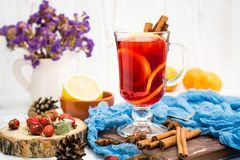 Hot tea with lemon and cinnamon in a glass Stock Photography