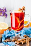 Hot tea with lemon and cinnamon in a glass. Royalty Free Stock Photography