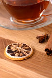Hot tea with lemon and cinnamon on wooden backgroubd Stock Photography