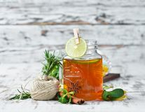 Hot tea with lemon and cinnamon. On a wooden background. Top view. Free copy space stock images