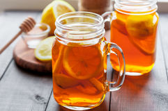 Hot tea with lemon and natural honey, good treat to have vitamins and strong immunity. Hot tea with lemon and honey, good treat to have vitamins and strong Royalty Free Stock Photos