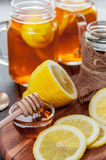 Hot tea with lemon and natural honey, good treat to have vitamins and strong immunity. Hot tea with lemon and honey, good treat to have vitamins and strong Stock Images