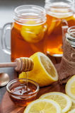 Hot tea with lemon and natural honey, good treat to have vitamins and strong immunity. Hot tea with lemon and honey, good treat to have vitamins and strong Royalty Free Stock Image