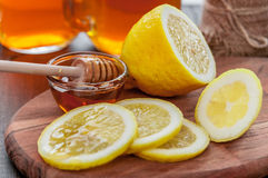 Hot tea with lemon and natural honey, good treat to have vitamins and strong immunity. Hot tea with lemon and honey, good treat to have vitamins and strong Stock Photography