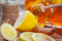 Hot tea with lemon and natural honey, good treat to have vitamins and strong immunity. Hot tea with lemon and honey, good treat to have vitamins and strong Royalty Free Stock Photography