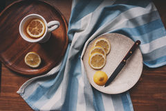 hot tea with lemon slices on wooden table, top view Royalty Free Stock Photos