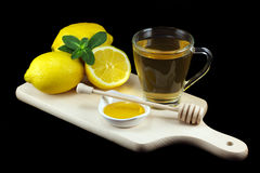 Hot tea with lemons and honey Royalty Free Stock Photos