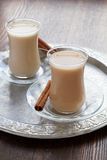 Hot tea with milk Stock Images