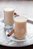 Hot tea with milk and spices Stock Images