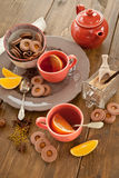 Hot tea / mulled wine and christmas cookies Stock Image