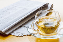 Hot tea and newspaper 2 Stock Photography