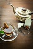 Hot tea and old tea pot Stock Image