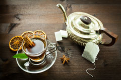 Hot tea and old tea pot Royalty Free Stock Photography