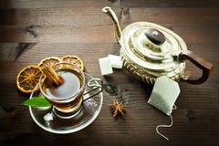 Hot tea and old tea pot Royalty Free Stock Photography