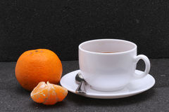 Hot tea and orange on the stone Royalty Free Stock Images