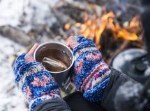 Hot Tea Outdoor near Fire Place Stock Photo