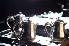 Hot tea pot on kitchen sink. Old tin tea or coffee pot Stock Photos