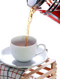 Hot tea poured into a cup Stock Photography