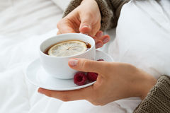 Hot tea with raspberries for flu Royalty Free Stock Photography