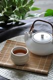 Hot Tea Set on Bamboo Mat. Japanese hot tea set put on bamboo mat royalty free stock image