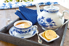Hot tea with a slice of lemon Royalty Free Stock Photo