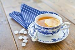 Hot tea with a slice of lemon stock image