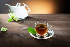 Hot tea in a small cup Stock Photos