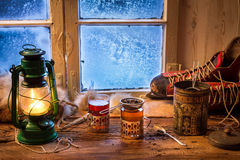 Hot tea in a small house at winter. Day Stock Photos