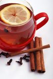 Hot tea with spices. Hot tea with cinnamon and cloves stock photography