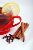 Hot tea with spices. Hot tea with cinnamon and cloves royalty free stock photos