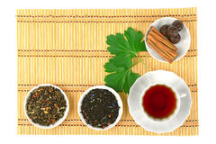 Hot tea with spices on a bamboo mat Royalty Free Stock Image