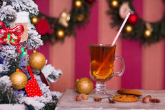 Hot tea with spices on old table on Christmas background, holida Stock Image