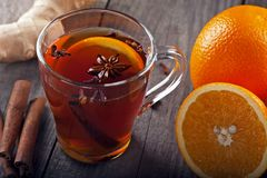 Tea with spices and oranges Royalty Free Stock Photography