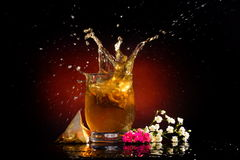 Hot tea splashing in the glass Royalty Free Stock Photos
