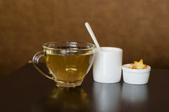 Hot tea with sugar and biscuit. Hot tea with sugar and star shape biscuit Stock Photo