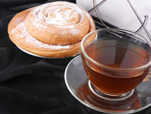 Hot tea with sweet cake on black background Stock Image