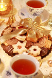 Hot tea with sweet cookies Stock Images