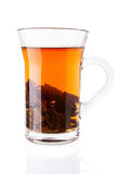 Hot Tea with Tea Leaves in Glass Cup Royalty Free Stock Photo