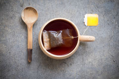 Hot tea with teabag in wooden cup Stock Photo