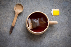 Hot tea with teabag in wooden cup Royalty Free Stock Images