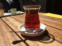 Hot tea. Traditional Turkish tea on street cafe table in tesvikiye Royalty Free Stock Photography