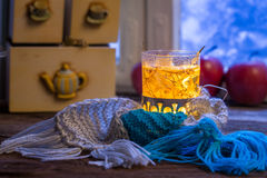 Hot tea treatment for cold evenings. At frozen window Royalty Free Stock Photo
