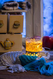 Hot tea treatment for cold evenings. On old wooden table Stock Photos