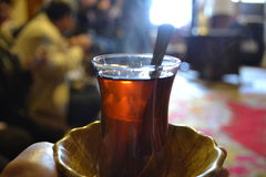 Hot tea in turkish small glass. In Turkey, they serve people hot tea in a small glass like this Stock Photography