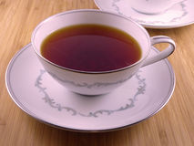 Hot tea in a white cup. Close-up on a cup with hot tea Royalty Free Stock Image