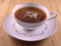 Hot tea in white cup. Tea in white cup on a wooden table Royalty Free Stock Photos