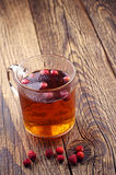 Hot tea with wild strawberries Royalty Free Stock Photography