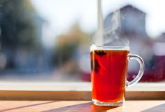 Hot Tea by Window Stock Image